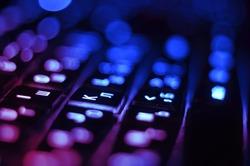 Luminous computer keyboard. Blue colour. Technologies, communications, the Internet, globalization