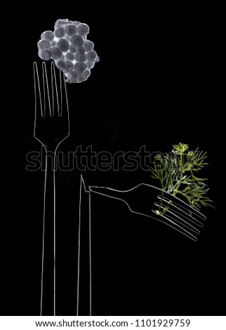 Luminous contours of whole and broken forks on black background. Opposition artificial and organic foodstuff. Prevalence of synthetic food over natural food. Space for text #1101929759
