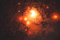 Luminous firecrackers spinning sparks of fire.