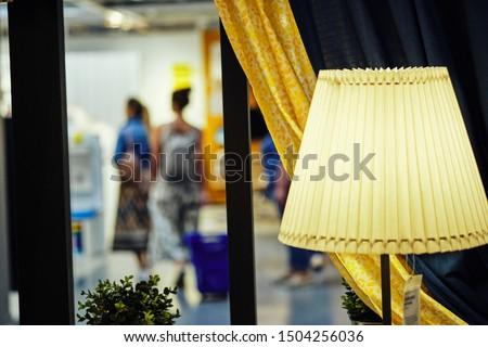 luminous lampshade on the windowsill in the interior