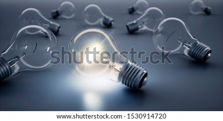 Luminous Lightbulb in Group of Lightbulbs - 3D illustration