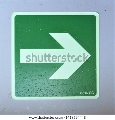 Luminous safety sign. This way arrow. #1419634448