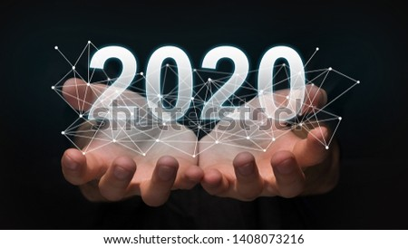 Luminous 2020 year numbers and network above man's hands at black background. New 2020 year technology concept.