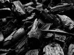 Lump charcoalis a traditional charcoal made directly fromhardwoodmaterial. the heap of charcoal after processed have different shapes and forms , light weight, rough surface,dark.