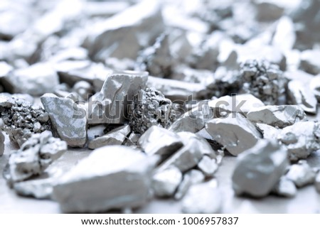 lump of silver or platinum on a stone floor #1006957837