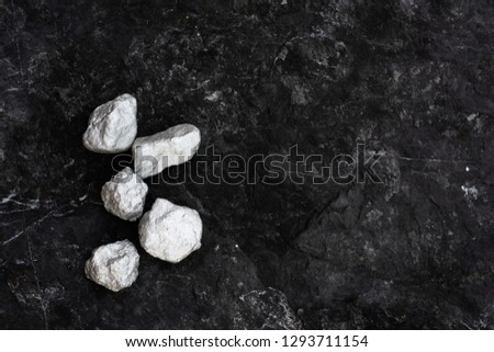 lump of silver or platinum on stone background #1293711154
