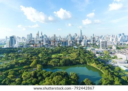 Lumpinee garden and Sathorn building in Bangkok, Thailand #792442867
