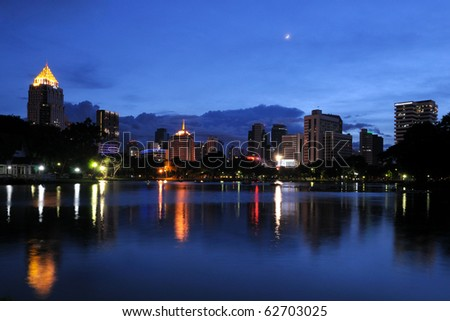 lumpini park and building at night