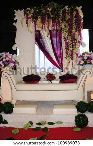LUMUT, MALAYSIA - APR 22: A decoration of Malay bridal throne display during Perak Bridal Carnival at Marina Island Hall on Apr 22, 2012 in Lumut Perak, Malaysia.