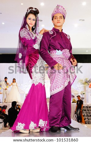 LUMUT, MALAYSIA - APR 22: Models walk the runway wearing Malay bridal dress during Perak Bridal Carnival at Marina Island Hall on Apr 22, 2012 in Lumut Perak, Malaysia.