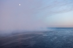 Luna and fog in the Baltic sea at evening time during white nights, St.Petersburg, Russia