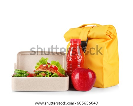 Lunch box and bag with delicious food on white background
