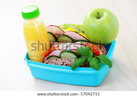lunch box with delicious sandwich and fruits - food and drink