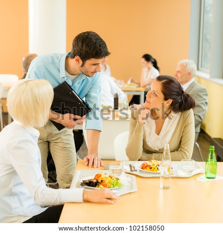 Lunch break office colleagues eat meal in cafeteria fresh salad