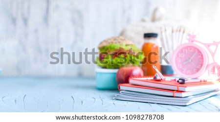 lunch for your child in school, box with a healthy sandwich and fruit salad and apple juice in the bottle for drinking