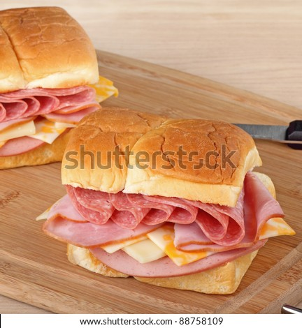 Lunch meat sandwiches on a cutting board