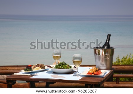 Photo of lunch table for two by the sea