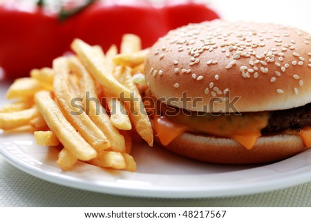 lunch time cheeseburger and french fries - food and drink