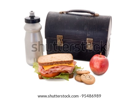 Lunchbox with water bottle, turkey sandwich, apple and cookies isolated on white