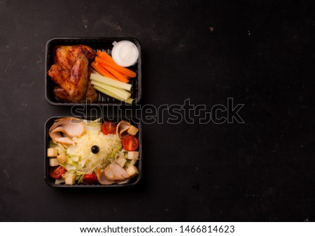lunches in black lunch boxes