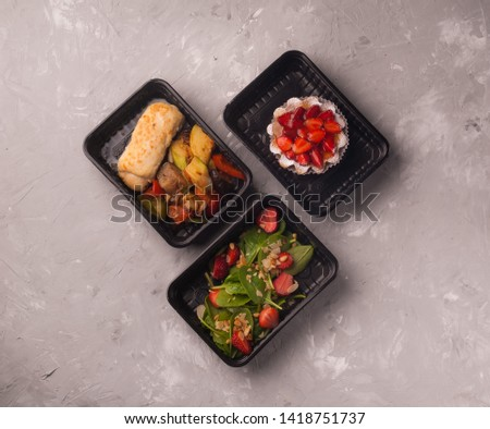 lunches in black lunch boxes for delivery