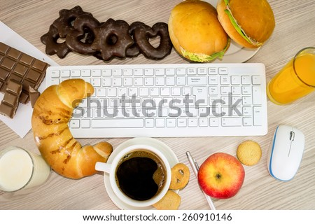lunchtime in office, keyboard covered with food that we eat during work