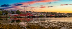 Lunenburg, Nova Scotia, Canada. Beautiful view of a historic port on the Atlantic Ocean Coast. Colorful Cloudy Sunrise Artistic Render. Panorama