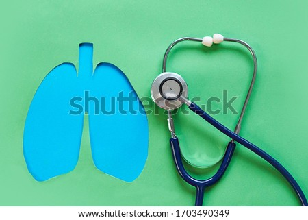 Lung health therapy medical concept . silhouette of the lungs and a stethoscope on a green background. concept of respiratory disease, pneumonia, tuberculosis, bronchitis, asthma, lung abscess