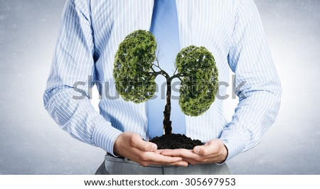 Lungs shaped tree in palms as symbol of nature protection