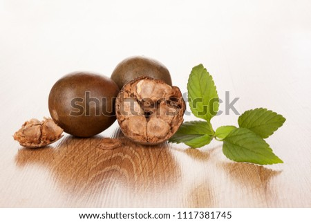 Luo Han Guo aka Monk fruit natural remedy on wooden background. Powerful healthy sweetener.