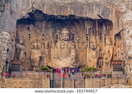 LUOYANG CHINA MAR 19 Visitors at Longmen grottoes on March 19 2014.It is one of the four notable grottoes in Luoyang Henan China A UNESCO World Heritage Site