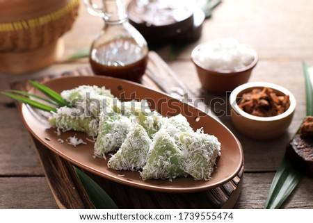 Lupis, Indonesian Traditional Snack Made From Sticky Rice, Wrapped with banana Leaf, shape Triangle  Served with Liquid Palm Sugar and Grated  Coconut  Zdjęcia stock ©