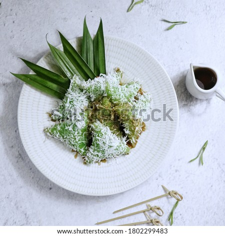 Lupis (sometimes lopis) is an Indonesian traditional sweet cake made of glutinous rice.Lupis is a typical Indonesian food, especially in Java. There are two common forms of lupis Zdjęcia stock ©