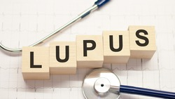 lupus word written on wooden blocks and stethoscope on light background. Healthcare conceptual for hospital, clinic and medical busines.
