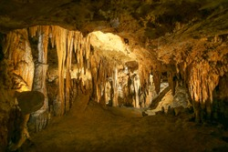 Luray Caverns,VA. Yellow backdrop. Stone texture. Usa travel.