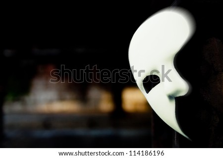 Photo of  Lurking in the Shadows - Phantom of the Opera Mask in Dark Tunnel