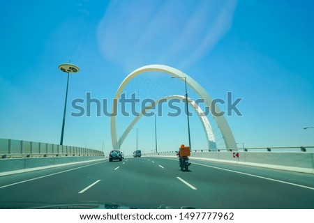 Lusail Expressway Memorial Arches large white structure crossing a highway interchange in Doha Qatar.