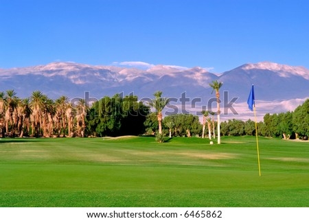 lush golf course green and oasis in california desert