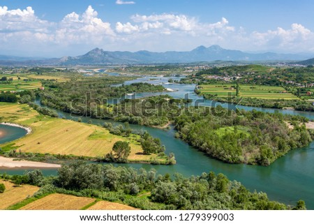 Lush green landscape of fields and rivers in northern Albania outside of Shkoder