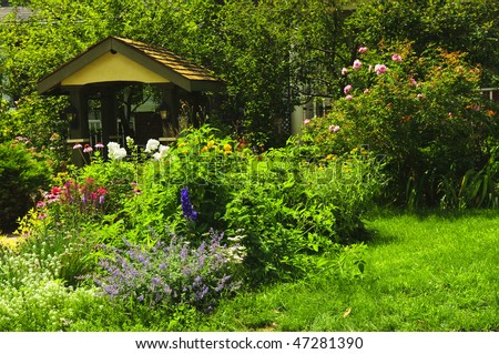 Lush green landscaped garden with flowers and gazebo
