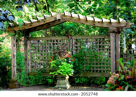 Lush japanese garden with wooden gate structure stock for Japanese garden structures wood