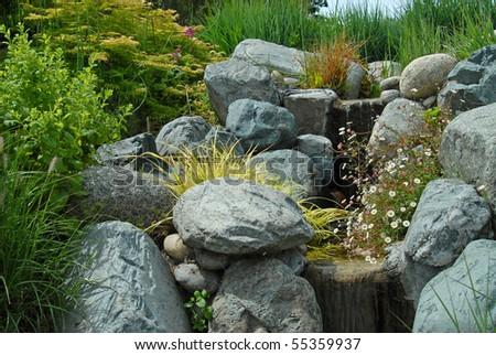 Lush mountain spring waterfall