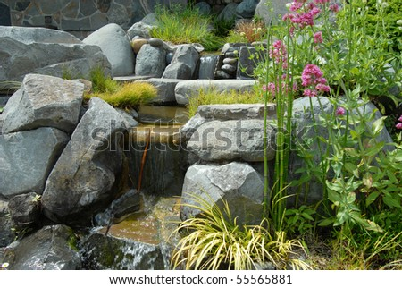 Lush mountain spring waterfall