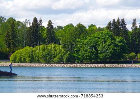 Lush trees and a lush lake. #718854253