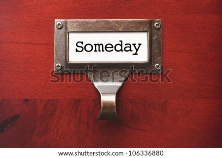 Lustrous Wooden Cabinet with Someday File Label in Dramatic Light.