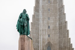 Lutheran church of Hallgrimskirkja with modern columns in Reykjavik, Iceland with bronze statue of Leif Erikson in downtown capital city