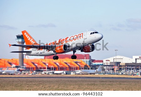 LUTON, ENGLAND - FEBRUARY 2: An Easy Jet Airbus A319 takes off from Luton airport on February 2, 2012 in Luton, England. In 2010, EasyJet carried 42.4 million passengers to 129 European & African destinations