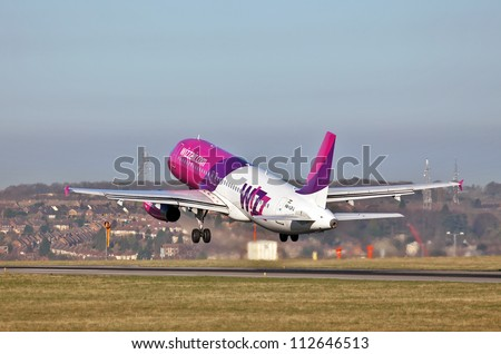 LUTON, UK - MARCH 28: A Hungarian Wizzair Airbus A320 jetliner leaves London Luton Airport on March 28, 2012 at Luton. Wizzair carried 11Mn passengers in 2011, an increase of 15% from 2010
