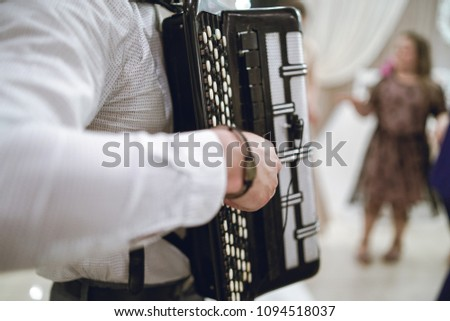 Lutsk, Ukraine, May 18, 2018: Young man musician playing the accordion #1094518037