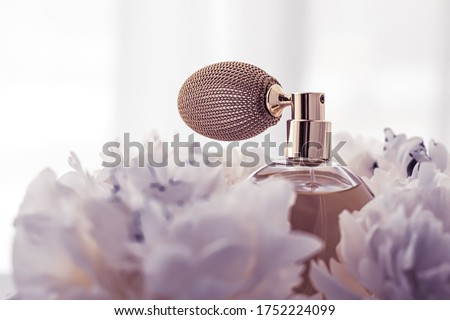 Luxe fragrance bottle as vintage perfume product on violet background and peony flowers, parfum ad and beauty branding design Stockfoto ©